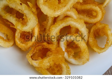 Tempura - squid rings served green onion and rucola leaves - stock photo