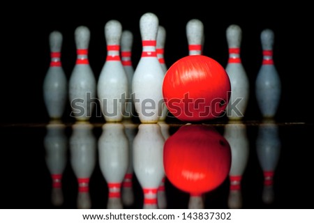 Ten bowling pins and bowling ball - stock photo