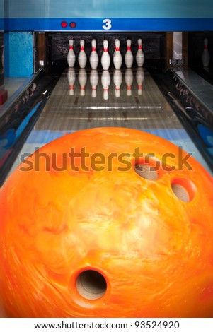 Ten bowling pins at the end of alley - stock photo