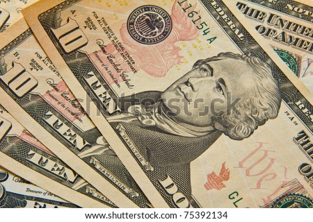 Ten dollar bills. - stock photo