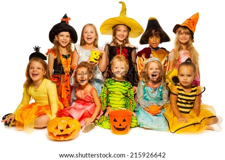 Ten kids in Halloween costumes together isolated - stock photo