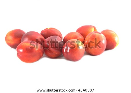 Ten nectarines isolated on white