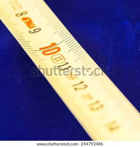 Ten Red Centimeter. Particular of a rolled meter - stock photo