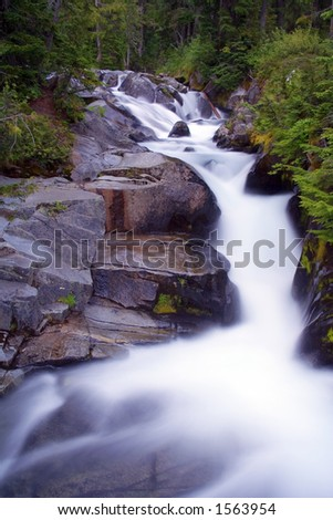 Ten Second Night Exposure of Paradise River, Mt. Rainier National Park, Washington State, USA - stock photo