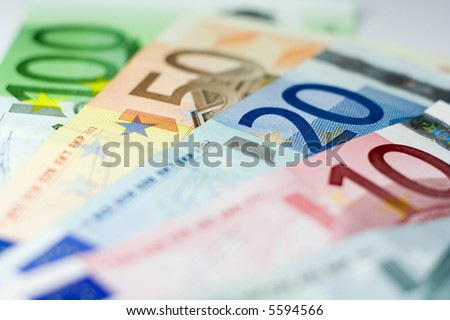 Ten, Twenty, Fifty, and One Hundred Euro banknotes with shallow depth of field and focus on the 20. - stock photo