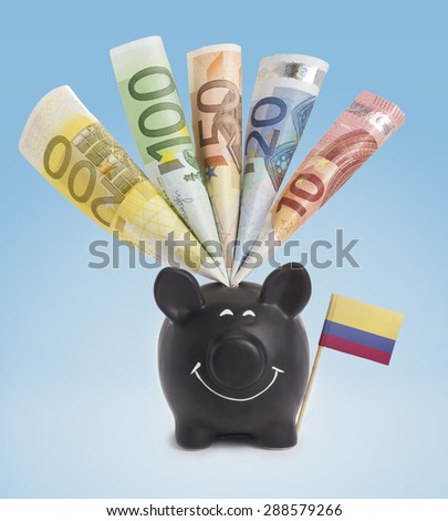 Ten,twenty,fifty,one hundred and a 200 Euro banknote in a smiling piggybank of Colombia.(series) - stock photo