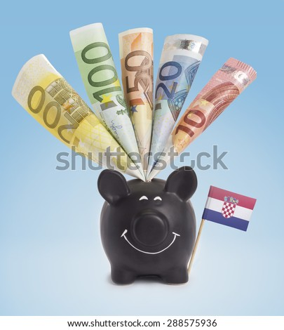 Ten,twenty,fifty,one hundred and a 200 Euro banknote in a smiling piggybank of Croatia.(series) - stock photo