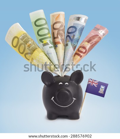 Ten,twenty,fifty,one hundred and a 200 Euro banknote in a smiling piggybank of Falkland Islands.(series) - stock photo