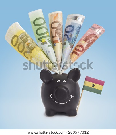 Ten,twenty,fifty,one hundred and a 200 Euro banknote in a smiling piggybank of Ghana.(series) - stock photo