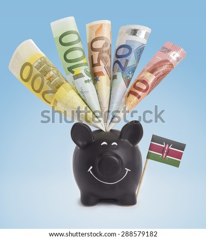 Ten,twenty,fifty,one hundred and a 200 Euro banknote in a smiling piggybank of Kenya.(series) - stock photo