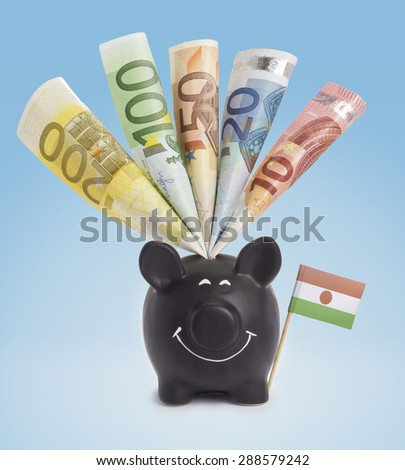 Ten,twenty,fifty,one hundred and a 200 Euro banknote in a smiling piggybank of Niger.(series) - stock photo