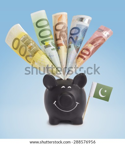 Ten,twenty,fifty,one hundred and a 200 Euro banknote in a smiling piggybank of Pakistan.(series) - stock photo