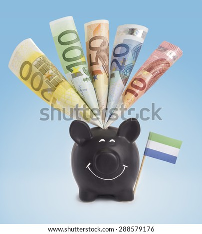 Ten,twenty,fifty,one hundred and a 200 Euro banknote in a smiling piggybank of Sierra Leone.(series) - stock photo