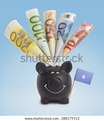 Ten,twenty,fifty,one hundred and a 200 Euro banknote in a smiling piggybank of Somalia.(series) - stock photo