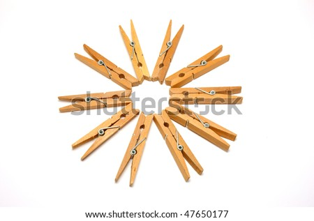 Ten wooden clothes pegs on a white background - stock photo
