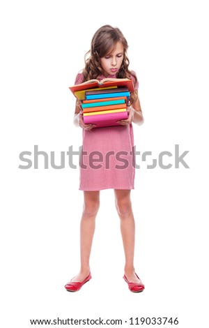 ten year girl standing with a stack of books. isolated on white background - stock photo