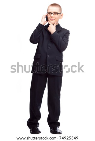 ten year old blond boy wearing a costume talking on the cellphone, isolated against white - stock photo