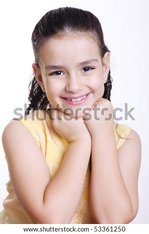 ten years old girl smiling and looking at the camera - stock photo