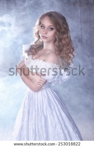 tender bride in white retro dress on smoke background
