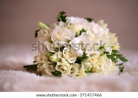 Tender elegant bridal bunch of splendid blooming creamy roses and tulips with green leaves traditional floral decor cute design for marriage ceremony on white background closeup studio, horizontal   - stock photo