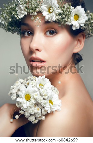 Tender floral beauty portrait of bride with fresh white camomile
