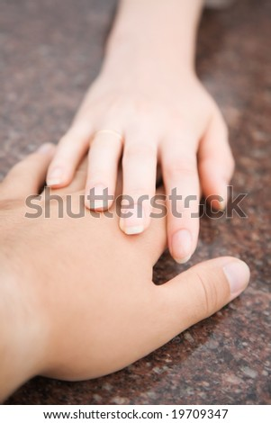 Tender hands. Man and woman stretching to each other.