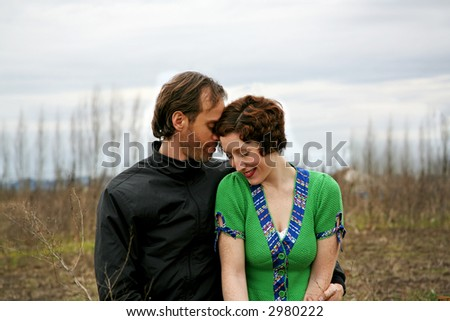 tender moment in a rural setting - stock photo