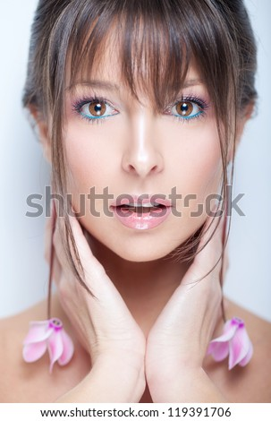 Tender portrait of a pretty girl with organic flower accessories - stock photo