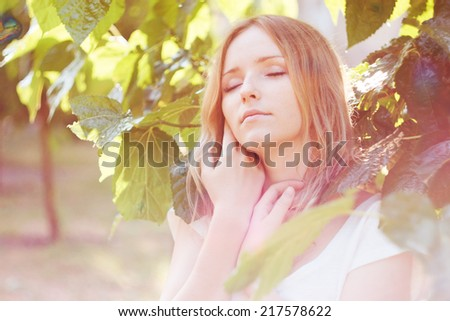 Tender portrait of beautiful girl. Closed eyes. Beautiful light