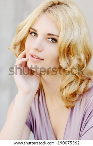 tender portrait of young blonde girl - stock photo