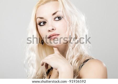 Tender woman face portrait, neutral background - stock photo