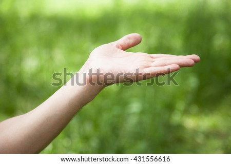 Tenderhearted gesture, closeup shot, natural green background