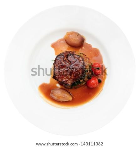 Tenderloin steak in plate, isolated on white background - stock photo