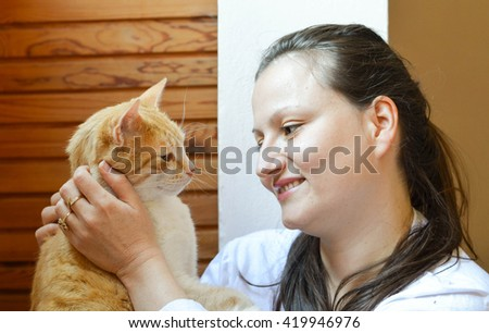 Tenderness between young woman and her cat - stock photo