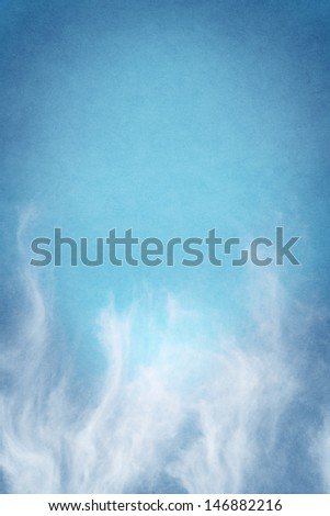Tendrils of rising fog on a turquoise blue background.  Image displays a pleasing paper grain and texture at 100 percent. - stock photo