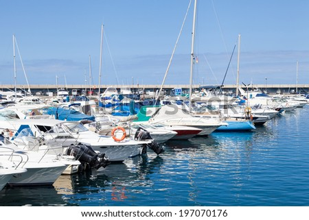 Tenerife, Canary Islands -July 22: Harbor view on July 22, 2013 in Tenerife, Canary Islands, Spain.Tenerife is the largest and most populous island of the seven Canary Islands, Spain. - stock photo