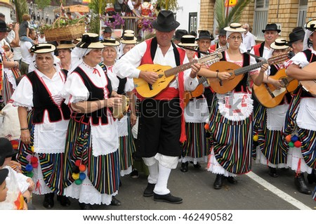 TENERIFE, CANARY ISLANDS - JUNE 21, 2009: Groups of men and women dressed in traditional costumes, singing in the Pilgrimage of Tegueste
