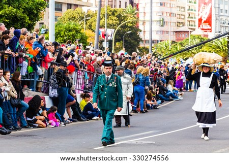 TENERIFE, FEBRUARY 17: Carnival groups and costumed characters, parade through the streets of the city. FEBRUARY 17, 2015, Tenerife, Canary Islands, Spain