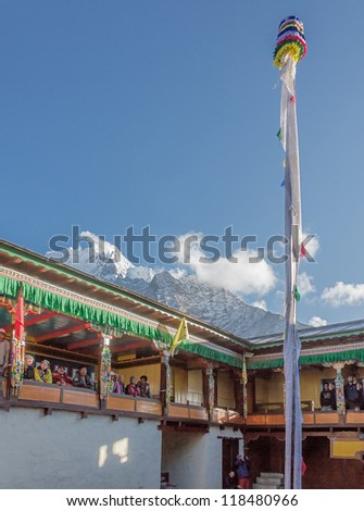 TENGBOCHE, NEPAL - OCTOBER 29: The monastic ritual column. Festival of Tengboche Monastery Practice and Masked Mani Rimdu Dances to the Khumbu region on October 29, 2012 in Tengboche - stock photo