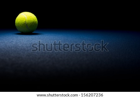 Tennis background - low key ball in corner with blue surface