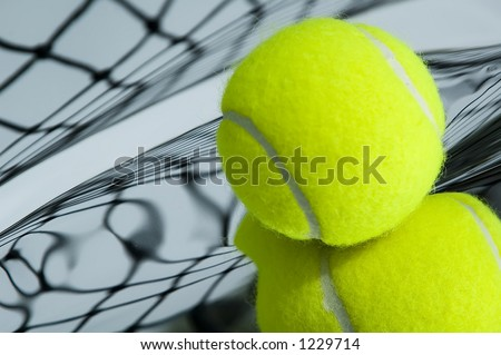 Tennis ball and net with distorted reflections - stock photo