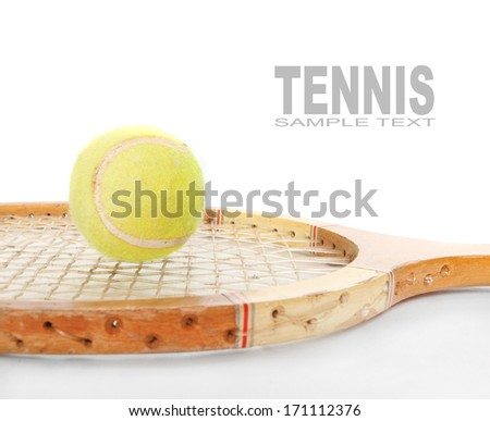 Tennis ball and racket from 1970s with space for your text.  - stock photo