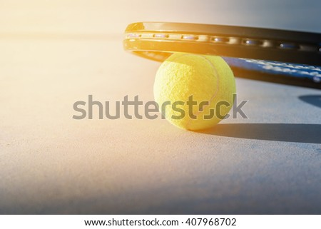 Tennis Ball and Racket. green color tennis ball. tennis ball from Thailand. Tennis ball on a tennis court - stock photo