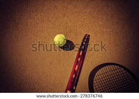 tennis ball and racket on hard court - stock photo