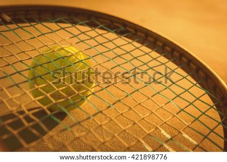 Tennis Ball and Racket on sunset.  - stock photo