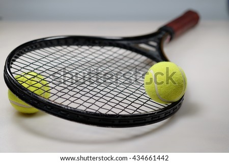 Tennis Ball and Racket on white background