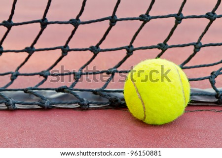 tennis ball and tennis net - stock photo
