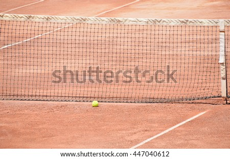 tennis ball at the net after a workout - stock photo