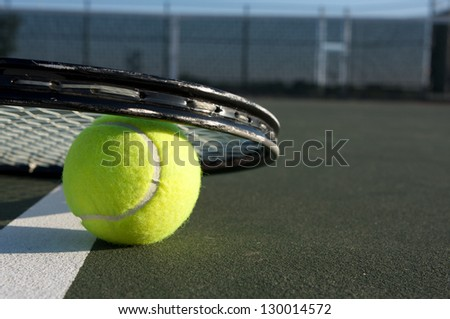 Tennis Ball Close Up and Racket with room for copy - stock photo