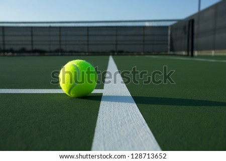 Tennis Ball Close up with Court Lines - stock photo